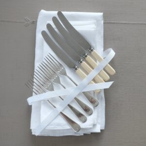 Vintage cutlery and linen set