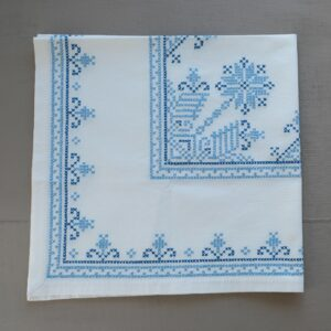 Blue and white cross stitch tablecloth